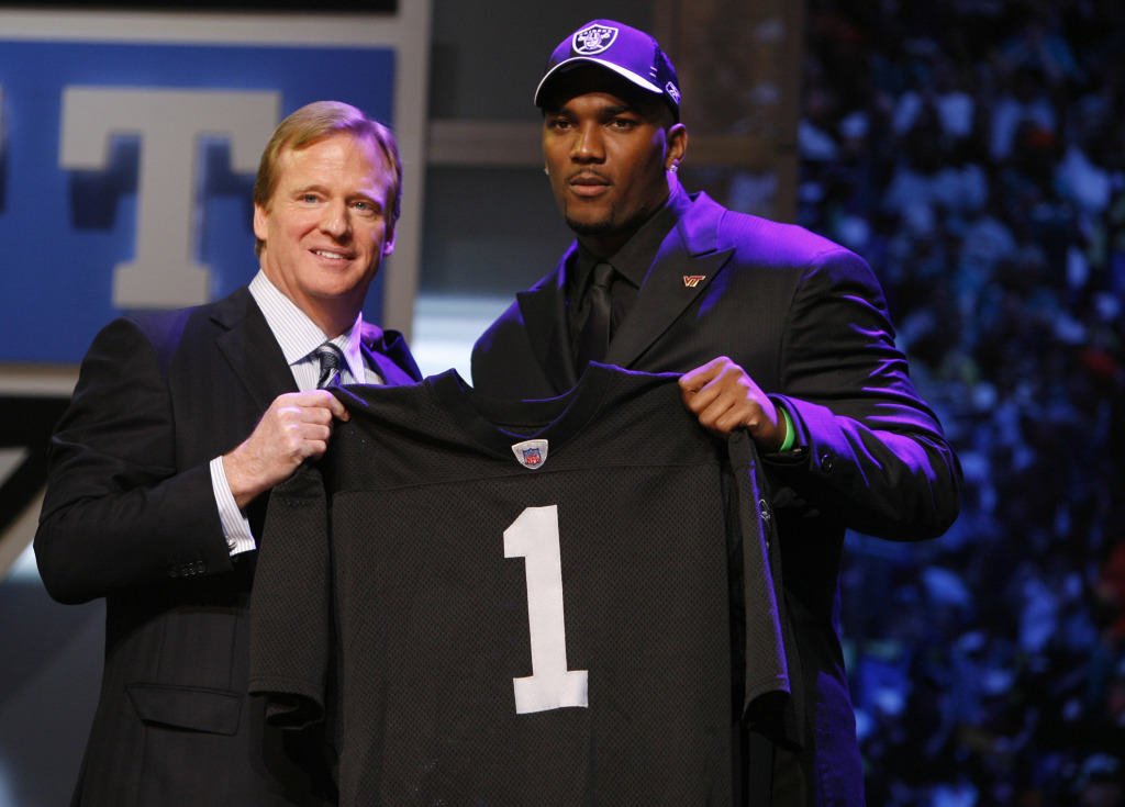 JaMarcus Russell, a quarterback from Louisiana State, stands with NFL Commissioner Roger Goodell after being selected by the Oakland Raiders as the No. 1 overall pick during the NFL Draft Saturday, April 28, 2007 at Radio City Music Hall in New York. (AP Photo/Jason DeCrow) ORG XMIT: NYFF110